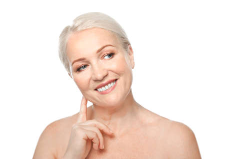 Portrait of beautiful mature woman on white background. Skin care concept