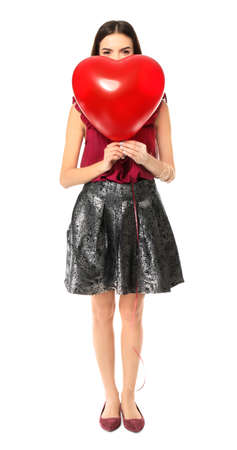 Romantic young woman with heart-shaped balloon for Valentine's Day on white background