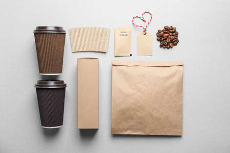 Composition with blank cups as mockups for branding on grey background Stock Photo