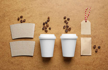 Composition with blank cups as mockups for branding on color background