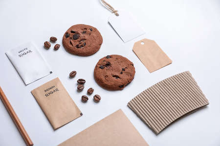 Composition with sugar packages and tags as mockups for branding on white background