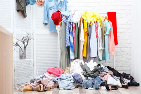 Messy dressing room interior with clothes rack Stock Photo