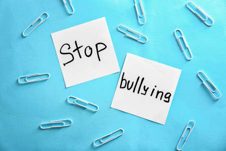 Notes with text Stop bullying on color background Stock Photo