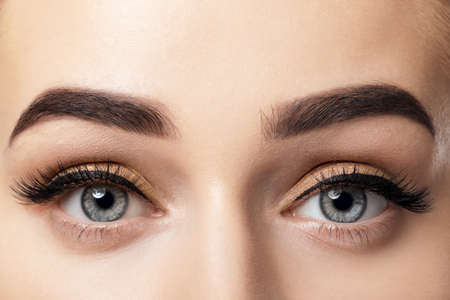 Young woman with beautiful eyebrows after correction, closeup Stock fotó - 99186395