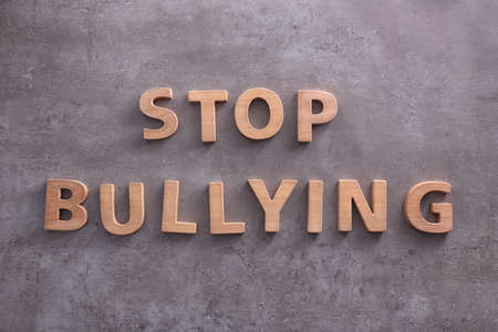Text Stop bullying on grey background