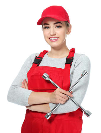Female auto mechanic with lug wrench on white background