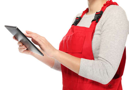 Female auto mechanic with tablet computer on white background, closeup