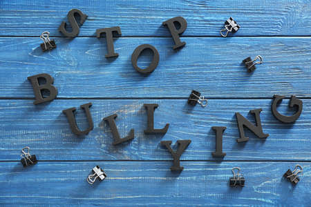 Text Stop bullying on wooden background