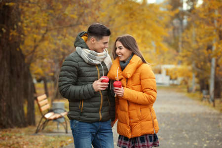Beautiful couple in warm clothes in park