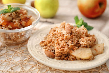 Plate with apple crisp on table, closeup Stock Photo