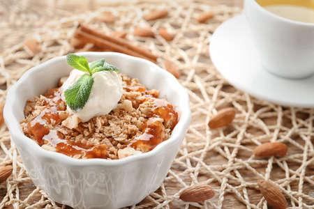 Ramekin with apple crisp and ice cream on table, closeup Stock Photo