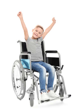 Little boy in wheelchair on white background