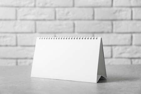 Blank desk calendar on table. Mockup for design Stock Photo