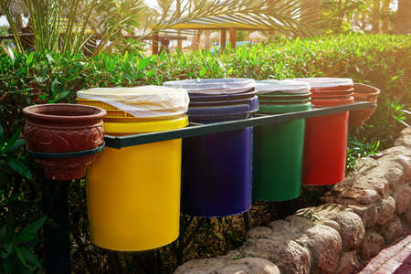 Different dustbins with trash outdoors. Recycling concept Фото со стока