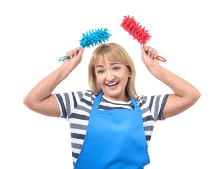 Portrait of mature woman in apron with fiber dusters on white background