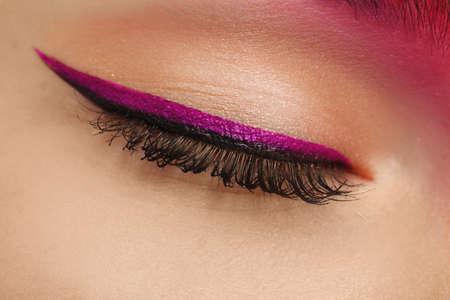 Young woman with bright makeup, closeup