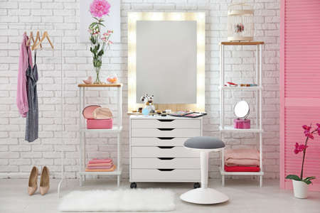 View of makeup room with decorative cosmetics and tools on dressing table Standard-Bild - 99261954
