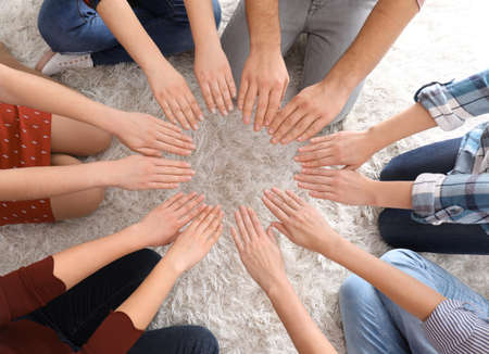Young people making circle with their hands as symbol of unity