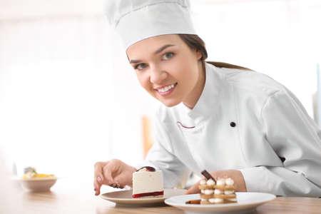 Female chef preparing tasty dessert in kitchen