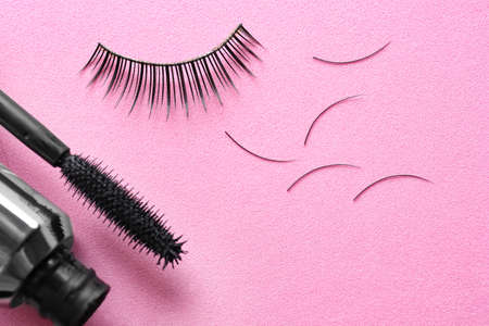Mascara and false eyelashes on color background Stock Photo