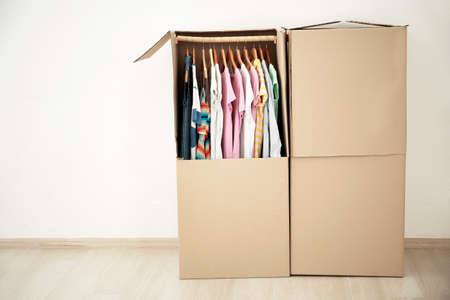 Wardrobe boxes with clothes indoors 免版税图像