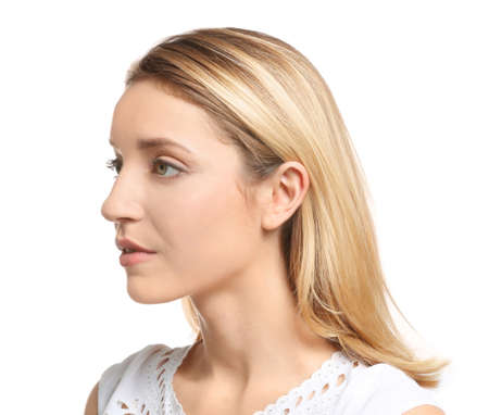 Young woman on white background. Hearing problem