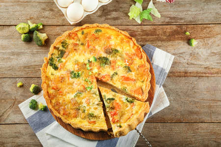 Tasty broccoli quiche on table
