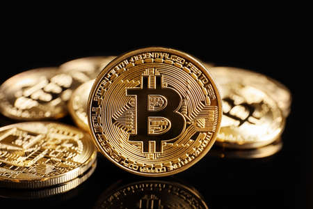 Golden bitcoins on black background Stock Photo