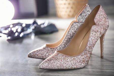 Beautiful high heeled shoes on floor