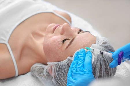 Beautician making injection in womans face, closeup. Biorevitalization procedure Stock Photo