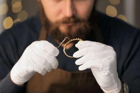 Jeweler working in workshop, closeup Stock Photo