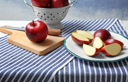 Composition with ripe red apples on table