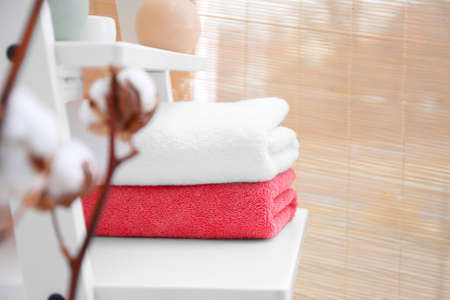 Clean towels on shelf in bathroom