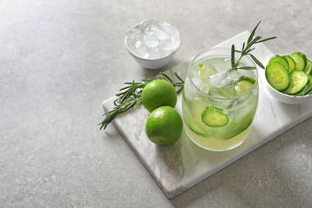 Jar with fresh lemonade and ingredients on table Stock Photo