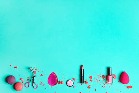 Decorative makeup products on color background Stock Photo