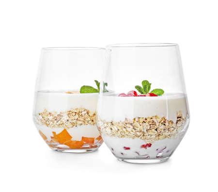 Yogurt with oat flakes in glasses on white background