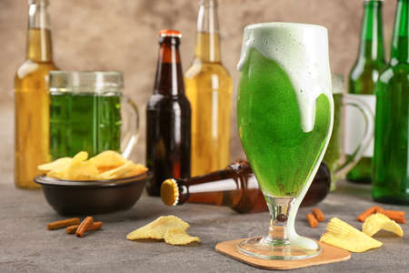 Glass of green beer on table. Saint Patricks day celebration Stock Photo