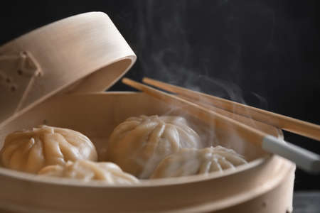 Bamboo steamer with baozi dumplings, closeup