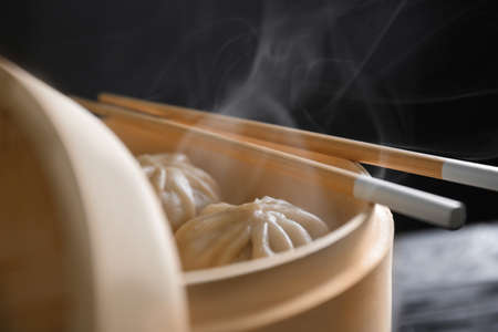 Bamboo steamer with baozi dumplings, closeup 写真素材