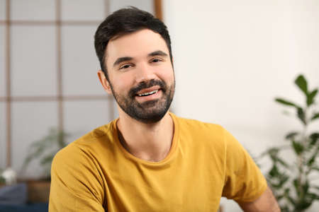 Young bearded man in casual clothes indoors Zdjęcie Seryjne