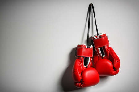 Boxing gloves on light background
