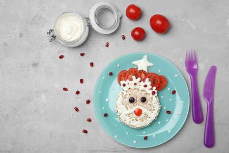 Creative breakfast for children on grey background, top view