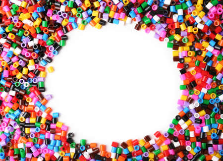 Colorful plastic beads on white background