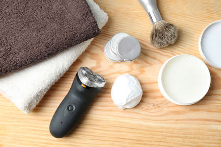Shaving accessories for man on wooden background Stock Photo