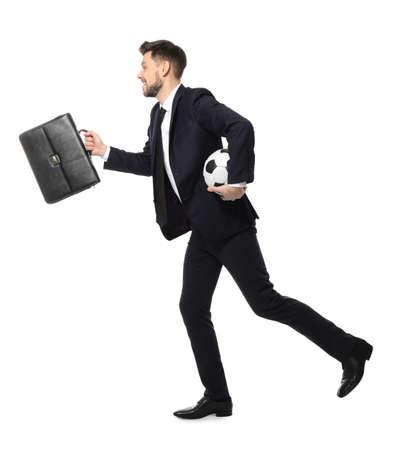 Young businessman with soccer ball and briefcase running on white background