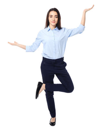 Young businesswoman showing balance gesture on white background Stock Photo