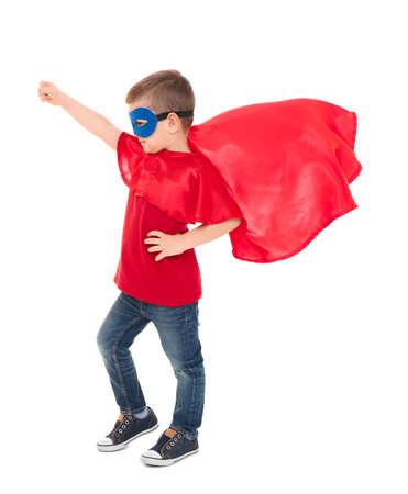 Cute boy in superhero costume on white background