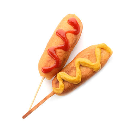 Tasty corn dog with ketchup and mustard on white background Banco de Imagens