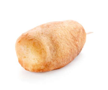 Tasty corn dog on white background