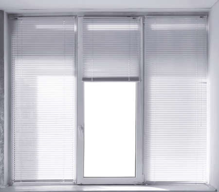 Window with modern white blinds